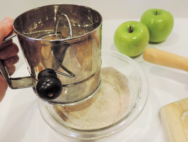 Sifting Apple Pie Bar Spices